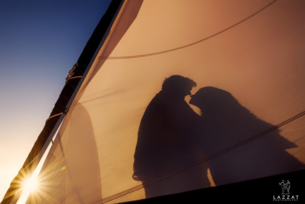 Stephanie and John Henry's shadow on the sail of the catamaran