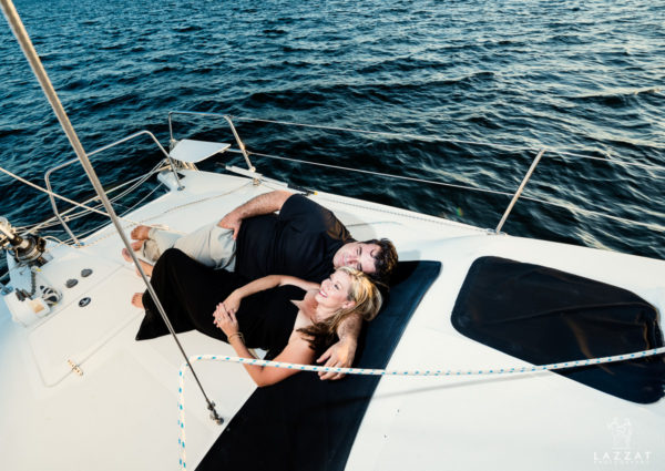 Stephanie and John Henry laying on the catamaran