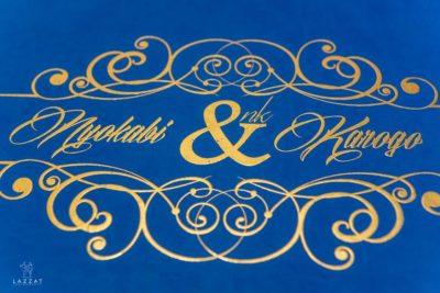 Close up of Nyokabi and Karogo's blue and gold logo