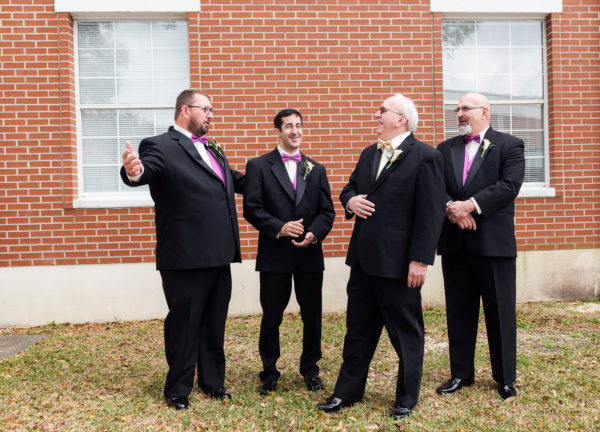 Deon laughing with his Groomsmen