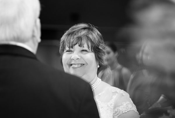 Melinda looking at Deon at the alter - black and white