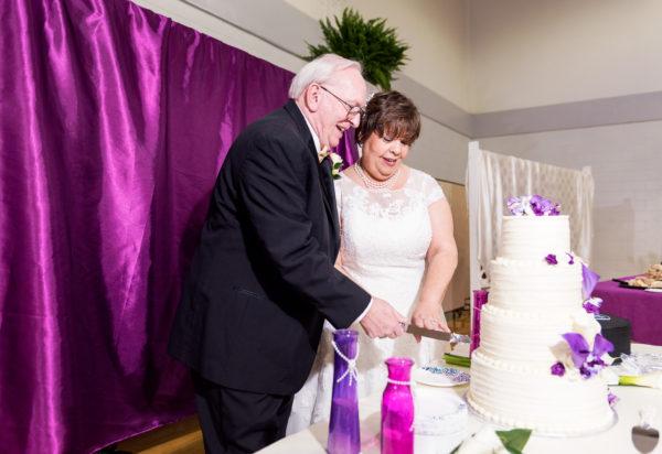 Melinda and Deon cutting their wedding cake