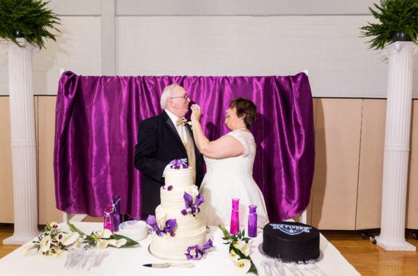 Melinda feeding Deon wedding cake