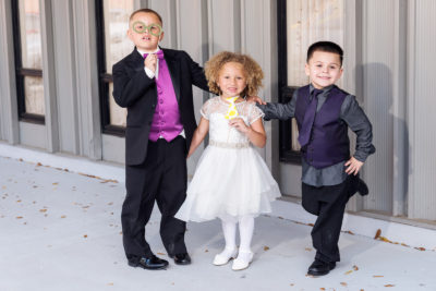 kids posing with Photo Booth props