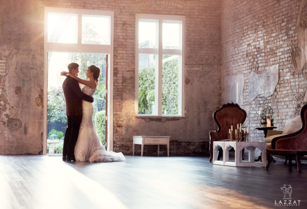 bride and groom in front of open doors at 5 Eleven Palafox