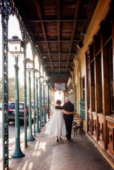 Melinda and Deon walking away outside Seville Quarter