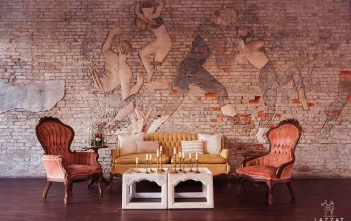 furniture in front of brick wall art at 5 Eleven Palafox