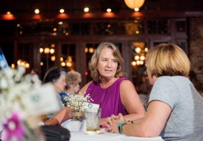 2 women talking at Seville Quarter reception