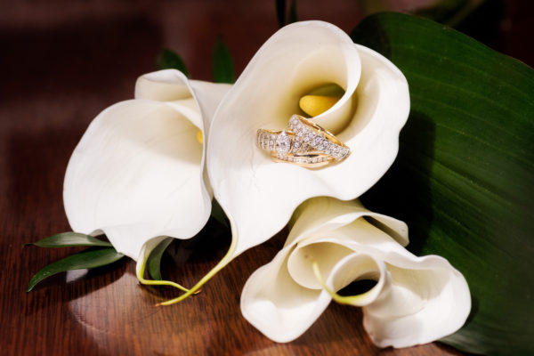 Melinda and Deon's rings in calla lily flower