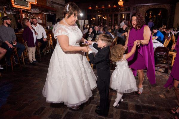 Melinda dancing with children in Seville Quarter