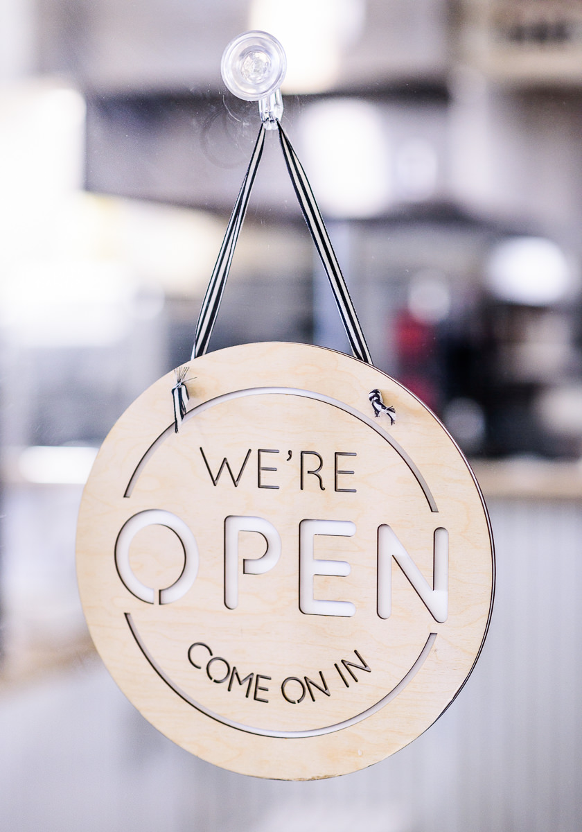 """Blue Jay's Bakery's """"we're open come on in"""" sign"""