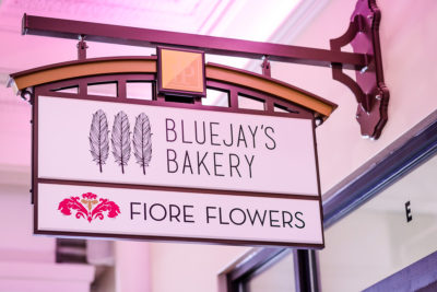 Blue Jays Bakery and Fiore Flowers signs