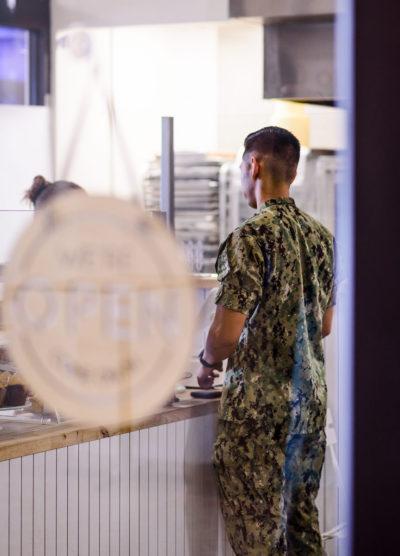 Man in Navy uniform ordering at Blue Jays Bakery