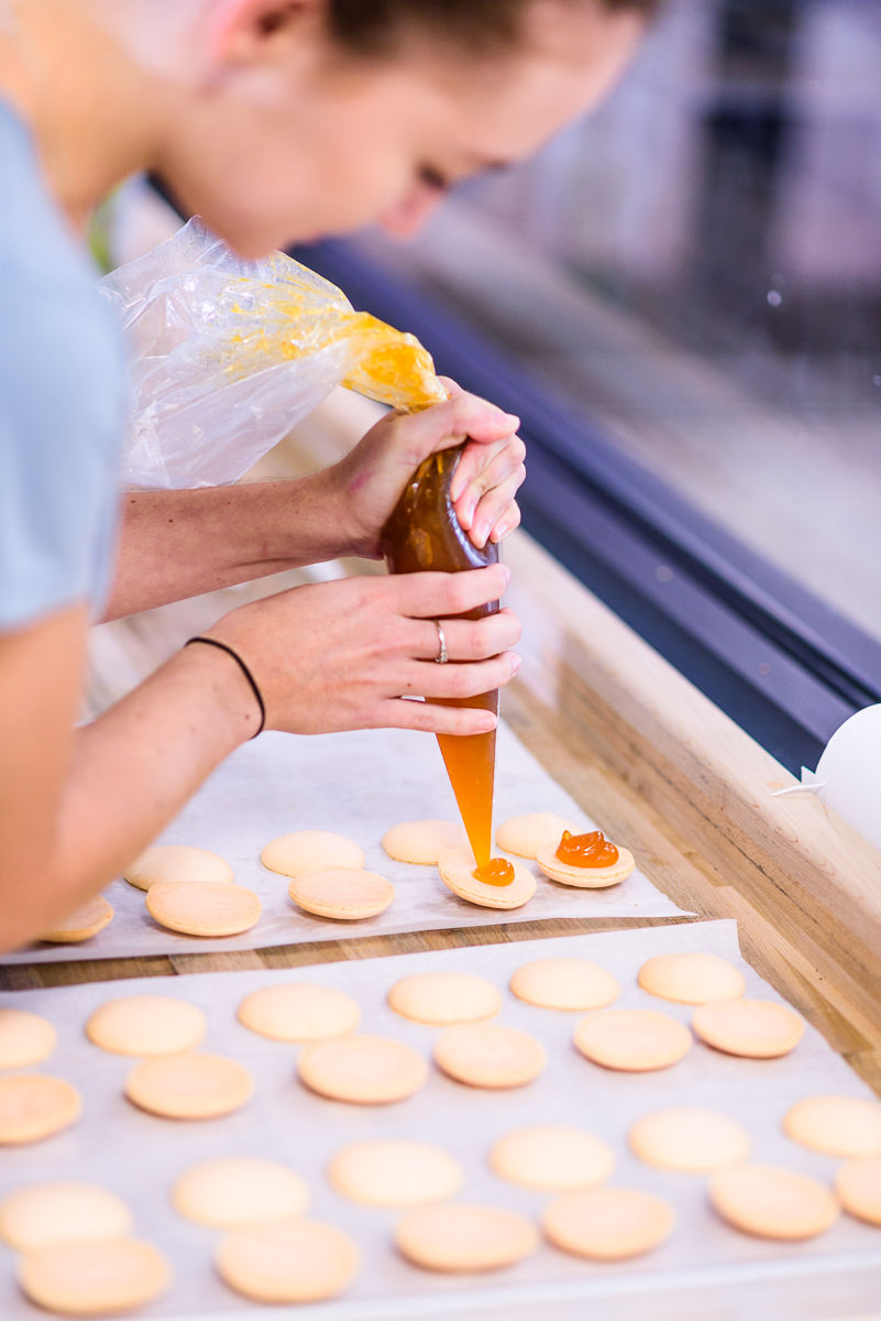 Woman from Blue Jay's Bakery making desserts