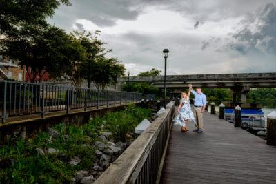 Rick spinning Carly | Downtown Milton Riverwalk Engagement