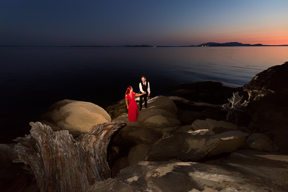 Couple walking on the rocks by the water at sunset, red dress, Larrabee State Park Engagement, Lazzat Photography, Engagement photos