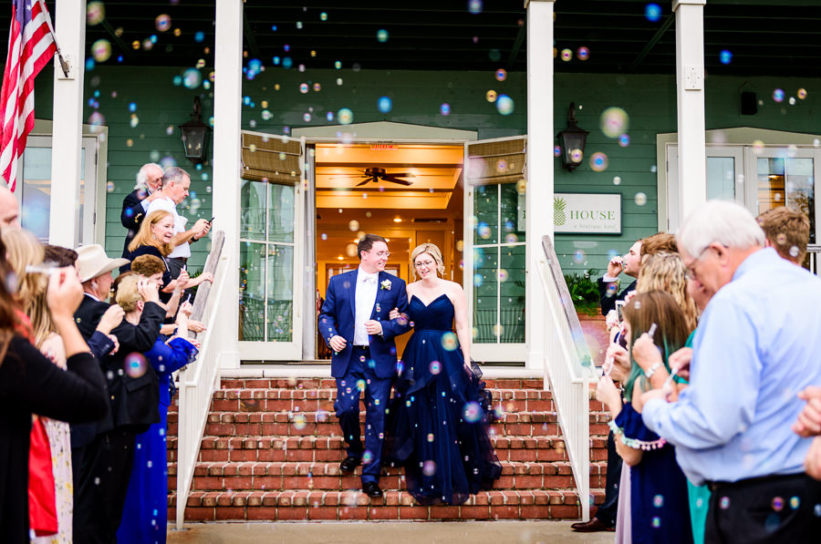 Bride and Groom's bubble exit, epic navy blue exit dress, Classic Pensacola Wedding, Lazzat Photography, Florida wedding photographer
