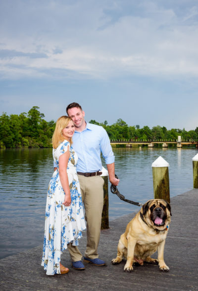 Carly and Rick with a dog | Downtown Milton Riverwalk Engagement