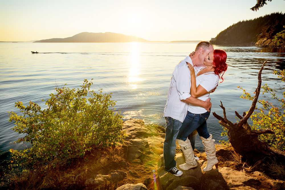 Man kissing his fiance's neck on the rocks by the water at sunset, Larrabee State Park Engagement, Lazzat Photography, Engagement photos