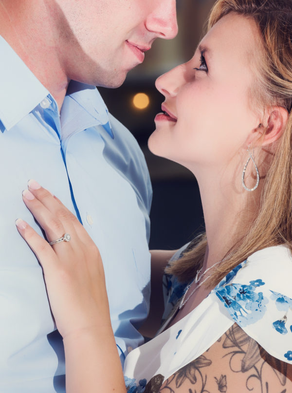 close up of Carly looking at Rick | Downtown Milton Riverwalk Engagement