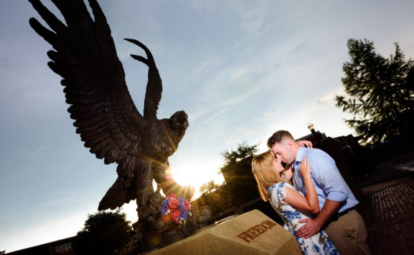 """Carly and Rick head to head in front of """"freedom"""" statue at their Downtown Milton Riverwalk Engagement photoshoot Downtown Milton Riverwalk Engagement"""