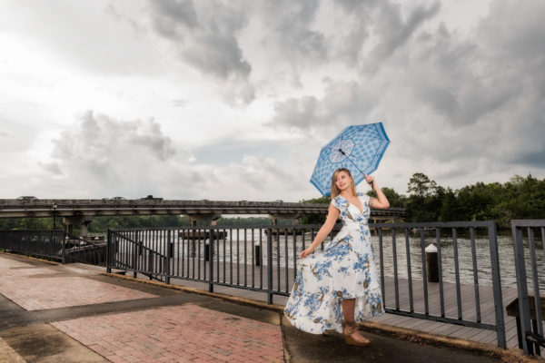 Carly with umbrella | Downtown Milton Riverwalk Engagement