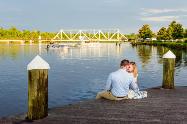 Carly and Rick almost kissing by the water - Downtown Milton Riverwalk Engagement