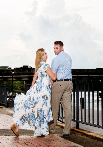 Carly and Rick looking back at the camera | Downtown Milton Riverwalk Engagement