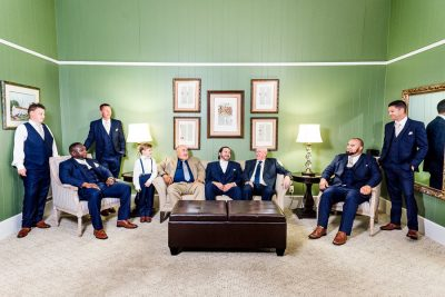 Downtown Pensacola Wedding, Cody and his groomsmen sitting in green room, Lazzat Photography