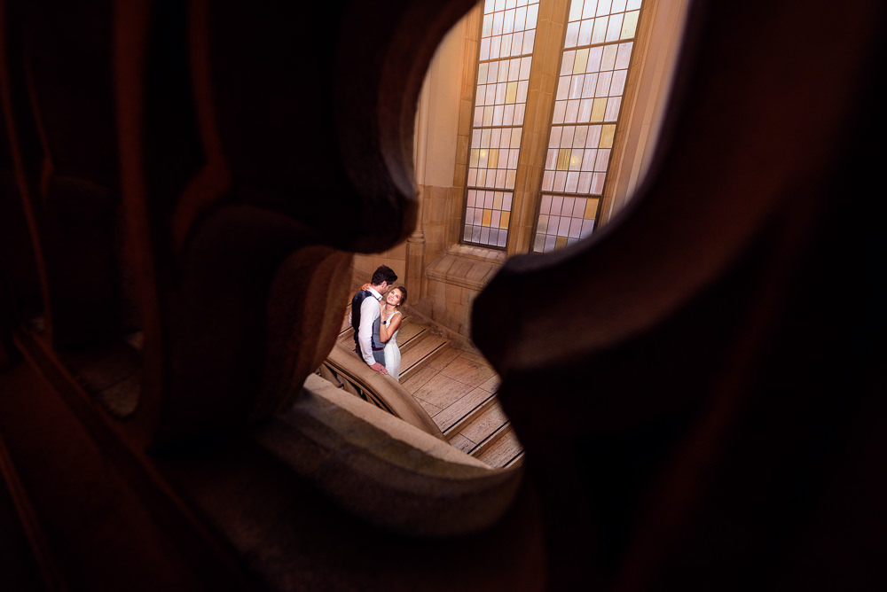 Couple through a keyhole in the Suzzallo library, Epic Couple's Session in Seattle, Lazzat Photography, Engagement photos, wedding photos