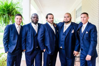 Downtown Pensacola Wedding, Cody and his groomsmen shoulder hugging, Lazzat Photography