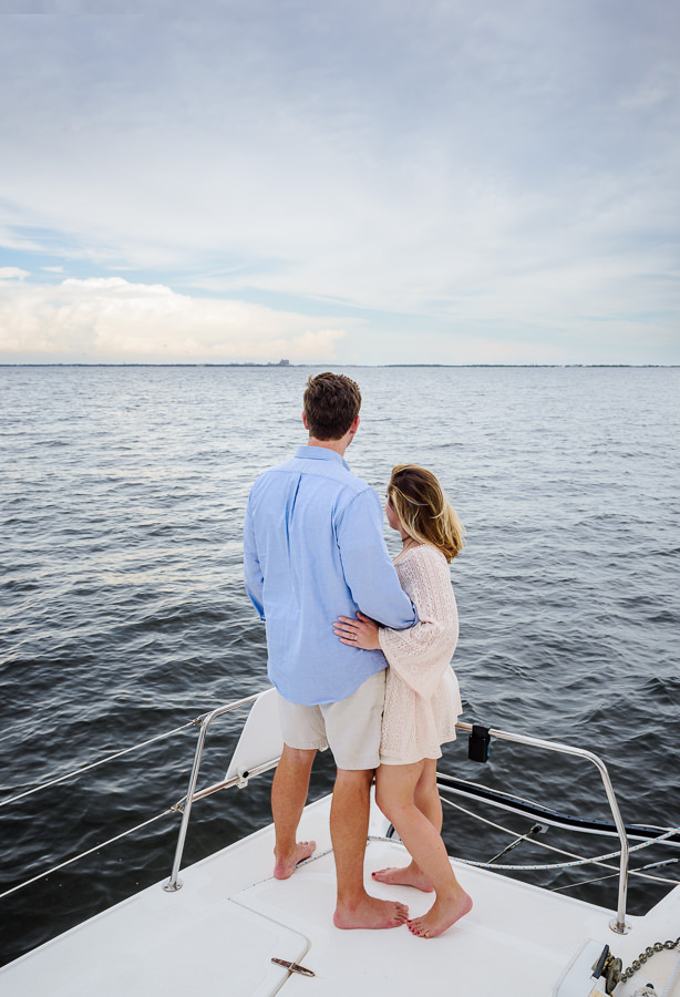 Newlyweds facing the water on a sailboat, Epic Pensacola Sunset Sailing, Lazzat Photography Sunset Sailing