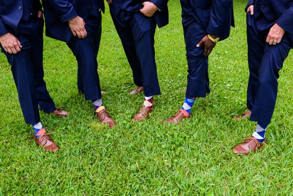 Downtown Pensacola Wedding, Cody and his groomsmen's sports team socks, Lazzat Photography