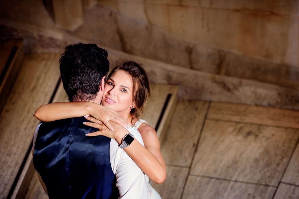 Woman smiling at the camera while hugging man in the Suzzallo library, Epic Couple's Session in Seattle, Lazzat Photography, Engagement photos, wedding photos