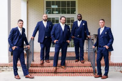 Downtown Pensacola Wedding, Cody and his groomsmen looking serious on the steps, Lazzat Photography