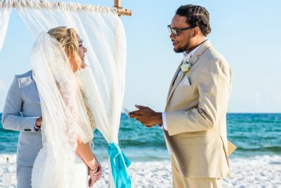 Pensacola Beach Destination Wedding, Delaine reading his vows to Desireé during their ceremony, Lazzat Photography