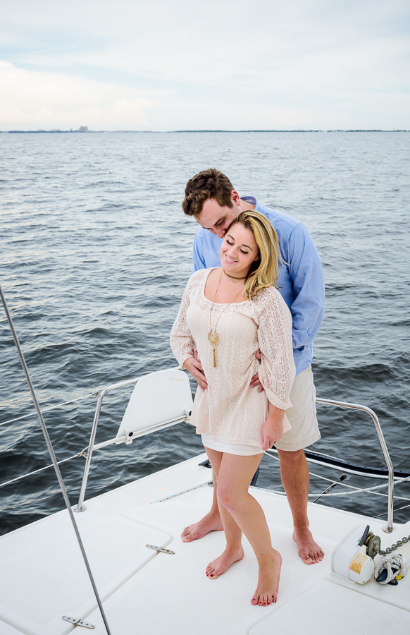Epic Husband kissing his wife's head on a sailboat, Epic Pensacola Sunset Sailing, Lazzat Photography Sunset Sailing