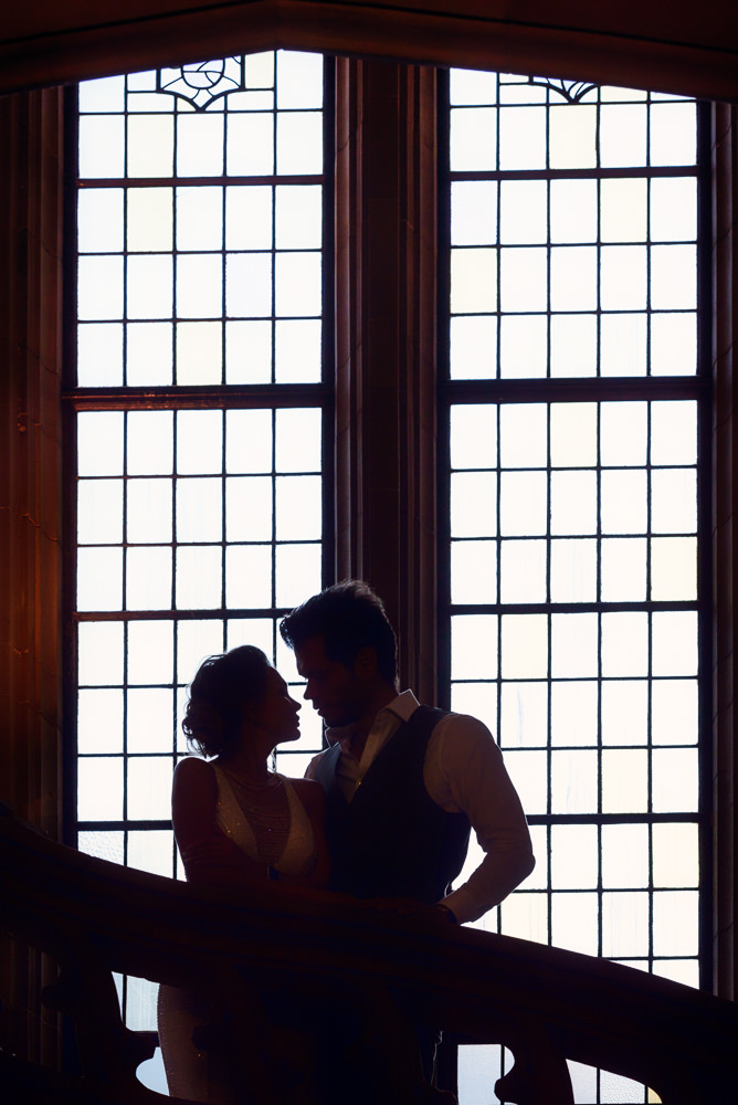 Couple looking at each other in front of windows in the Suzzallo library, Epic Couple's Session in Seattle, Lazzat Photography, Engagement photos, wedding photos