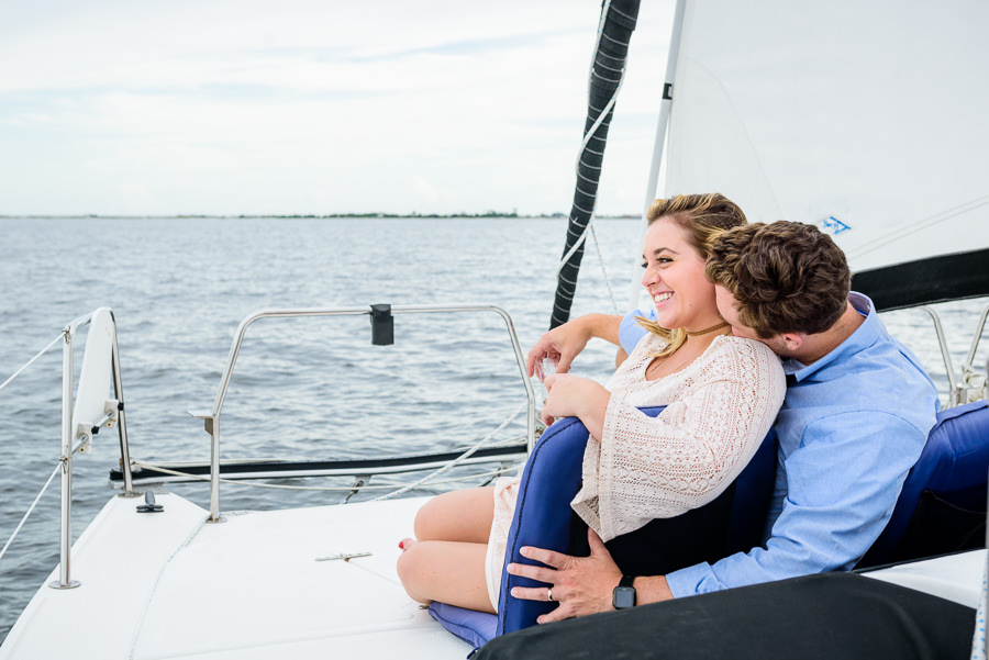 Husband kissing his wife's neck on a sailboat, Epic Pensacola Sunset Sailing, Lazzat Photography
