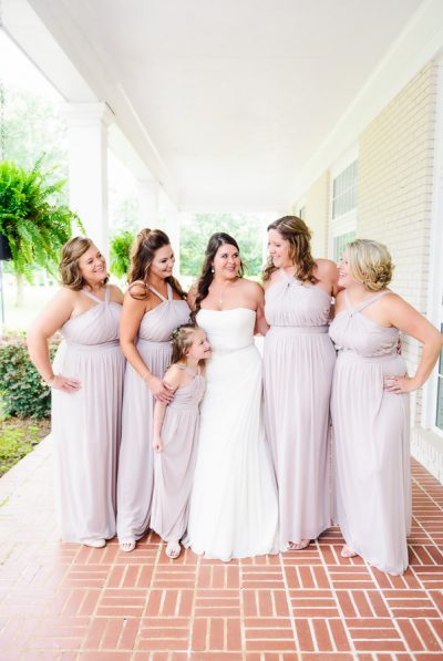 Downtown Pensacola Wedding, Kerri with her bridesmaids looking at her, Lazzat Photography