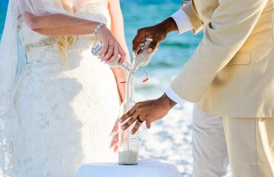 Pensacola Beach Destination Wedding, Desireé and Delaine pouring their unity sand during their ceremony, Lazzat Photography