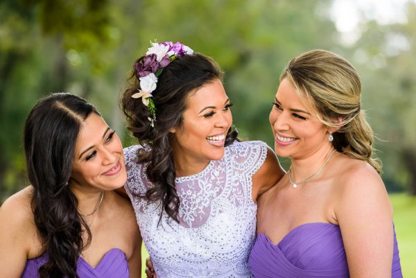 close up of Michelle smiling at her Bridesmaids, Ates Ranch Wedding Barn, Rustic Barn Wedding, purple bridesmaids dresses, Pensacola wedding photographer, Lazzat Photography