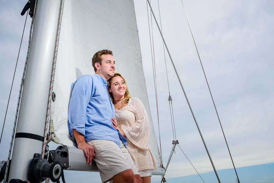 Newlyweds looking out over the ocean on a sailboat, Epic Pensacola Sunset Sailing, Lazzat Photography