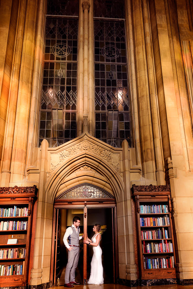 Couple looking at each other in the doorway of the Suzzallo library, Epic Couple's Session in Seattle, Lazzat Photography, Engagement photos, wedding photos
