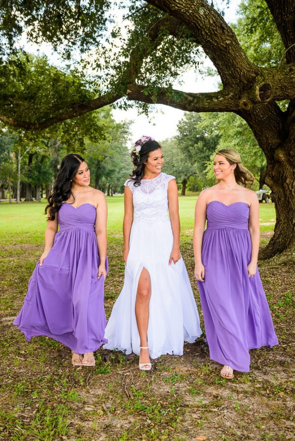 Michelle walking with her Bridesmaids outside, Ates Ranch Wedding Barn, Rustic Barn Wedding, purple bridesmaids dresses, Pensacola wedding photographer, Lazzat Photography