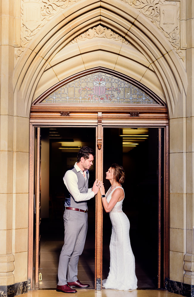 Close up of couple looking at each other in the doorway of the Suzzallo library, Epic Couple's Session in Seattle, Lazzat Photography, Engagement photos, wedding photos