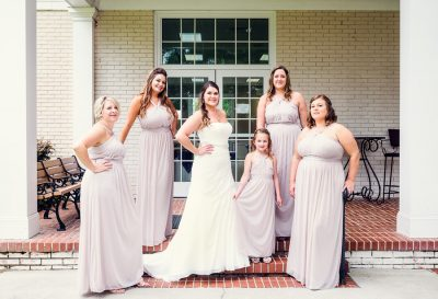 Downtown Pensacola Wedding, Kerri with her bridesmaids on steps outside, Lazzat Photography
