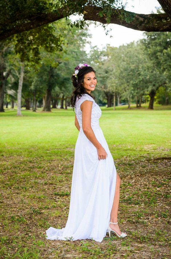 Michelle looking back and smiling outside, Ates Ranch Wedding Barn, Rustic Barn Wedding, Pensacola wedding photographer, Lazzat Photography
