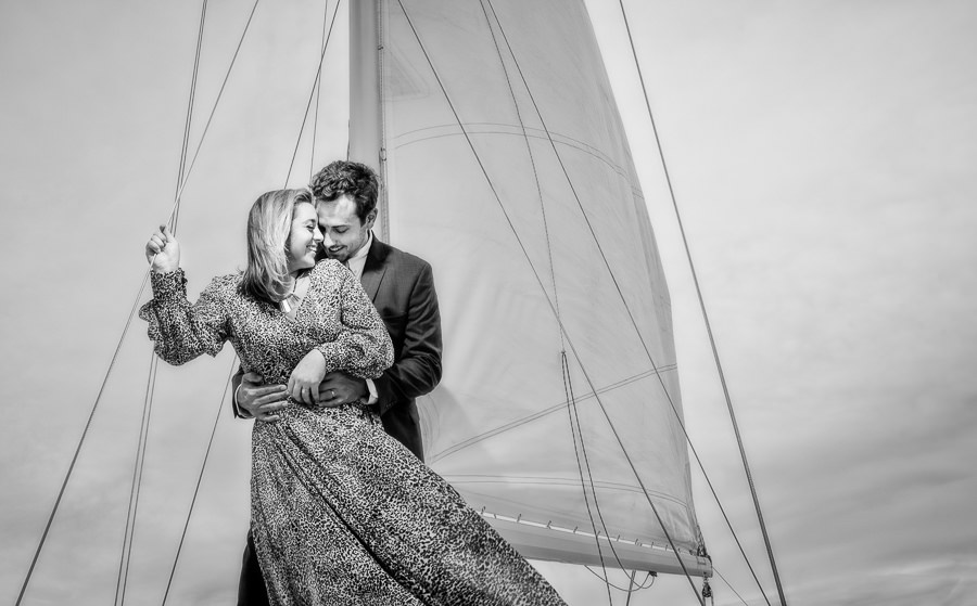 Newlyweds giggling on a sailboat, Epic Pensacola Sunset Sailing, Lazzat Photography