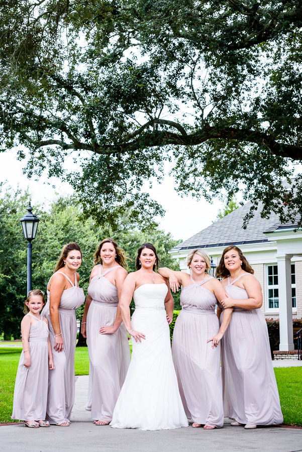 Downtown Pensacola Wedding, Kerri with her bridesmaids outside, Lazzat Photography